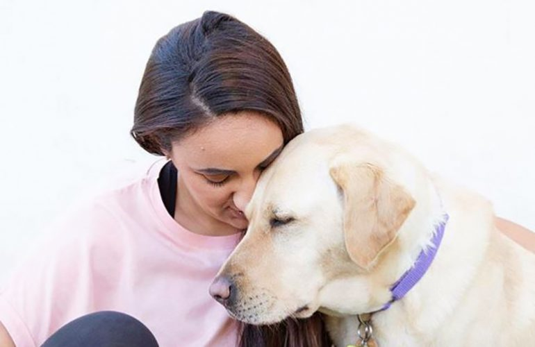 Chrissy and Guide Dog Lacey participate in PAWGUST