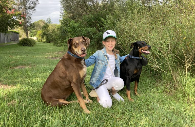 Young dog walker supports Puppy Pals